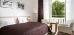 Doppelzimmer-Wohnbeispiel mit Balkon