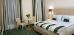 Doppelzimmer-Wohnbeispiel im Grünton