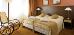 gemütliches Doppelzimmer mit Schaukelstuhl