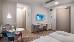 Veränderte Perspektive im Wohnbeispiel Doppelzimmer (im Bild; Sitzecke, Schreibtisch, Fernseher)
